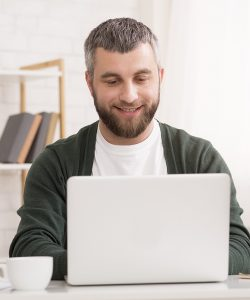 smiling-entrepreneur-working-from-home-chatting-wi-XK26PGN.jpg